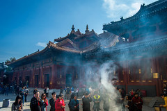 Prayers (Julien//K) Tags: china travel red people colors architecture outdoors temple nikon asia smoke beijing kitlens buddhism prayers lamatemple d3200 encents