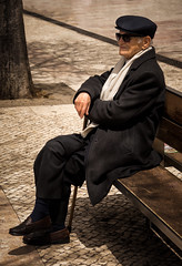 'A River Runs Through It' (Canadapt) Tags: street man portugal hat cane scarf bench sitting lisbon cap elder gentleman dapper stately overcoat dignified canadapt