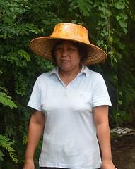 woman wearing new palm leaf hat (the foreign photographer - ) Tags: woman hat thailand leaf nikon bangkok palm 63 aged middle soi bangkhen d3200 phahoyolthin jun262016nikon