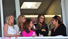 Coleen Rooney watching the races with friends during Liverpool Day at the John Smith's Grand National Festival at the Aintree Racecourse Liverpool, England