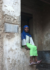 Teenage Girl Sitting In The Street , Lamu, Kenya (Eric Lafforgue) Tags: africa color cute beauty vertical bench island photography sitting kenya islam hijab culture tranquility happiness unescoworldheritagesite serenity teenager afrika tradition amused lamu youngadult swahili afrique adolescence eastafrica qunia lamuisland lafforgue oneteenagegirlonly traveldestination kenyaafrica 1213years  qunia islamicveil  118979   kea 1415years exterioroutdoors   tradingroute a beautifulcutepretty