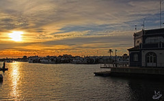Al caer el dia (Urugallu) Tags: espaa sol canon mar spain flickr barca huelva colores loveit ci