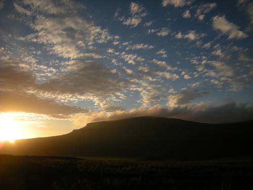 Sunset over Pen-y-Ghent (photo by ANTHONY LEWIS)
