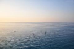 Across the sea (pau'lin) Tags: ocean blue sunset sea summer sky italy sun holiday water boat nikon ship horizon d90 nikond90
