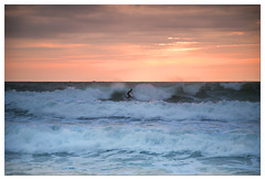 Surfer, Grand Plage, Biarritz Small (Ashley Lowry) Tags: pink blue light sunset sea orange sun seascape france beach landscape evening bay coast seaside europe surf waves power sundown dusk surfer board foam surfboard powerful biarritz ocan bayofbiscay acquitaine hugewaves grandplage atantic
