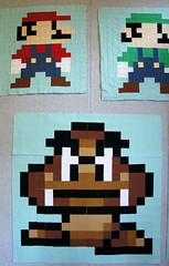 All three blocks so far! (Cut To Pieces) Tags: game quilt nintendo mario fabric luigi solid goomba michaelmiller supermariobrothers quiltalong cottoncouture cuttopieces supermariobrosqal