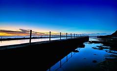 Blue Morning (evangelique) Tags: ocean morning light sky sun beach water pool sunrise reflections concrete dawn rocks sydney clear newport nsw railing tidal tidalpool northernbeaches oceanbath beachpool