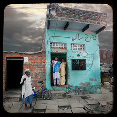 The hijras' house (designldg) Tags: people india house square women village muslim atmosphere streetlife soul varanasi hindu dharma sari benares benaras hijra sarees uttarpradesh  thirdsex