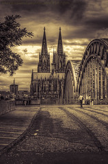 Cologne Cathedral in sepia (mlphoto) Tags: street city bridge sky blackandwhite bw sepia clouds pentax cologne himmel kln stadt brcke hdr klnerdom colognecathedral hohenzollernbrcke k20d pentaxk20d mlphoto markuslandsmannzenfoliocom markuslandsmann