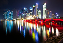 Singapore - Marina Bay Skyscrapers (Mathew Roberts) Tags: bridge light night marina reflections bay singapore colours skyscrapers raffles 2011 mathewroberts