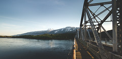 Bridge over the River (eric.vanryswyk) Tags: sky mountain lake snow canada mountains water clouds forest river landscape dawn golden coast twilight nikon outdoor dusk columbia hills cap shore hour british 20mm nikkor f18 revelstoke shuswap monashees d610 monashee