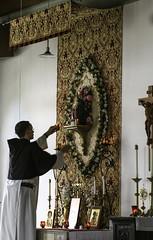 Votives for Our Lady of Walsingham (Lawrence OP) Tags: statue candles monk wv charlestown votives newjerusalem ourladyofwalsingham canonsregular