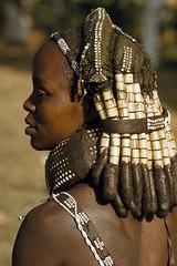 Angola. A Mwila mother wears her hair in thick, beaded locks.  Humpata // Volkmar K Wentzel (mike catalonian) Tags: africa portrait face angola southernregion photographycolor humpata mwila volkmarkwentzel