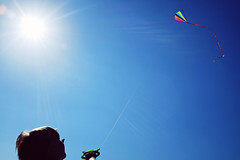 Into the blue - Fujifilm X100t (polybazze) Tags: blue boy summer vacation sky sun holiday kite hot colors children fun fly flying colorful warm fuji child happiness flare fujifilm malm sibbarp limitless x100t