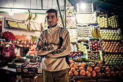 My Vegetables Merchant recommand you to eat 5 fruits & vegetables per day fo your health. (aminefassi) Tags: africa street portrait people copyright orange apple shop fruit lumix artistic retrato vegetable banana panasonic morocco health maroc soul merchant hdr marokko moroccan sant 2012 rabat legumes lightroom  photographe m43 mft marocain moroko marchant  marueccos epicier retratto vegetebales microfourthirds 20mmf17 aminefassi