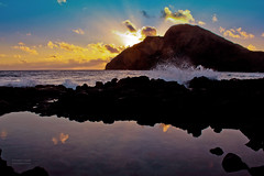 Makapu`u Tidepool Sunrise (RobertCross1 (off and on)) Tags: ocean lighthouse reflection beach silhouette clouds sunrise canon dawn hawaii surf waves pacific oahu splash dslr tidepool waimanalo windward msm makapuu t2i mygearandme mygearandmepremium mygearandmebronze mygearandmesilver mygearandmegold mygearandmepla
