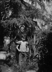 Sailor and his little brother (?), ca. 1940 (ChrisWarren1956) Tags: california vintage backyard uniform patriotic pride siblings worldwarii sailor enlist outdoorportrait