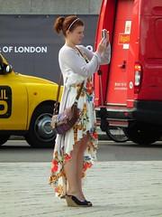 Feminine Fotoist (kenjonbro) Tags: uk woman london girl westminster fashion lady female dress feminine trafalgarsquare curtains brunette posh handbag charingcross sw1 aiming photgrapher kenjonbro fujihs10