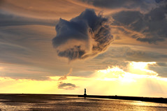 Unusual Cloud over Portage Lake Channel (Katy Silberger) Tags: sunset lighthouse silhouette clouds lakemichigan portagelake stormcloud northernmichigan summerstorm the4elements nikond90 onekamami onekamanorthpier