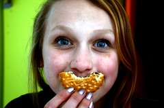 biscuit smile (DAY 65) (pommedapie) Tags: portrait white colors girl smile fun colorful cookie colours bright blueeyes biscuit colourful 365project