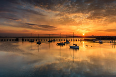 Sunburst (Sunset Snapper) Tags: uk sunset sea water beautiful reflections boats nikon harbour may peaceful hampshire filter lee nd sunburst serene yachts posts grad southcoast tranquil 2016 2470mm langstoneharbour d810 sunsetsnapper