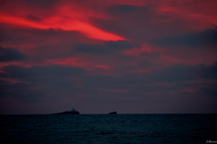 Reflejos de fuego (juliosabinagolf.) Tags: sunset espaa costa color clouds nikon cielo nikkor nube cabodepalos d3300 cloudsstormssunsetssunrises