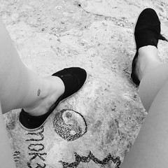 (t-nary) Tags: blackandwhite bw feet rock digital shoe graffiti nikon shoes paint shot symbol adventure yang balance yinyang yin d5300
