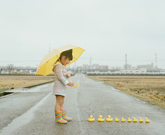 Stalker (Toyokazu) Tags: family portrait girl rain yellow duck child stalker pentax67