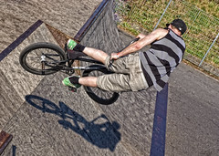 BMX Tricks (Explored) (G8lite) Tags: bmx flickr shadows spin streetphotography explore finepix fujifilm extremesports spins actionphotography adrenalinerush streetsports trickriding explored s5pro flickrexplored freezingmotion highactionphotography bmxcycles g8lite