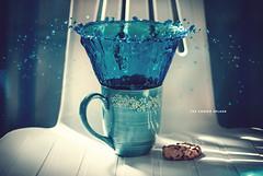 Day 191/365: The Cookie Splash (jennydasdesign) Tags: blue water 50mm drops chair cookie dof bokeh turquoise mug 365 splash kaka liquid 2012 bl mugg turkos project365 365days sonydslra300 dt50mmf18sam