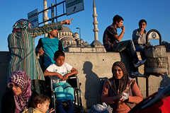 Late Afternoon - Istanbul, Turkey (Maciej Dakowicz) Tags: street city family shadow turkey islam wheelchair istanbul mosque disabled metropolis sirkeci eminonou