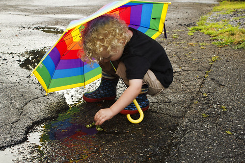 boy playing reflection cute rain contrast umbrella canon puddle kid rainbow child bright boots young free blonde littlekid abbikenny