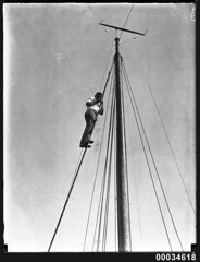 Man on a ladder at the peak of a mast, 1890-1953