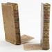 55. Pair of Decorative Leather Bound Book Bookends