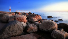 Heavy As We Are (tinamar789) Tags: blue sunset sea moon seascape landscape pier spring helsinki rocks horizon rocky hour seashore lauttasaari