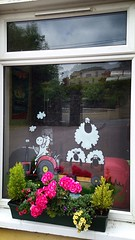 Veterinary window (JulieK (had forgotten what hard work puppies are)) Tags: flowers ireland irish plants window sheep artistic vet cork newmarket windowbox bedding hww