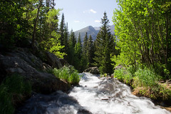Running Water Off a Cliff (puffclinty) Tags: park trees summer mountain creek river waterfall colorado slow rocky evergreen national shutter