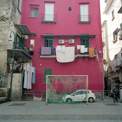 (The Spirit of Football Lies in the Streets) (Robbie McIntosh) Tags: windows red 120 6x6 film field analog mediumformat square football goal kodak soccer streetphotography clothes hasselblad negative laundry porta balconies analogue piazza rosso portra calcio bucato finestre soccerfield footballpitch panni balconi pellicola hasselblad500cm analogico portra160 mittelformat moyenformat filmisnotdead medioformato kodakportra160 campodicalcio carlzeissdistagon50mmf4ct