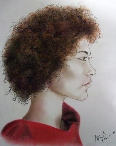 Profile pose of a woman with an afro