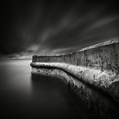 Silver Lining (Andy Brown (mrbuk1)) Tags: longexposure cloud seascape detail texture water wall contrast dark square mono blackwhite movement moody fineart dramatic 11 ridge impact lowkey defences mottled tonality neutraldensity 10stop