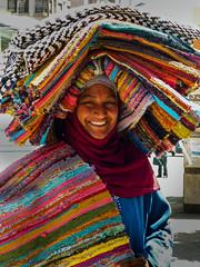 Woman in Cairo (Lau31) Tags: portrait woman color colour smile couleurs egypt tapis sourire caire tissus cairote
