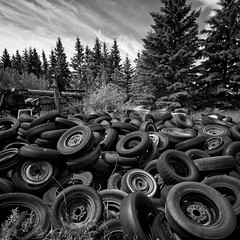 I've been tired (martinfowlie) Tags: sky blackandwhite canada clouds canon decay machinery pines alberta 7d rubbish left tones ruraldecay wispy tyres thepixies dumped thegoldmine ivebeentired