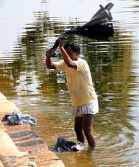 Washerman in Shiv Sagar (bokage) Tags: india man pond washing khajuraho dhobi madhyapradesh shivsagar