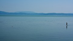 Lago Trasimeno (Natalia Romay Photography) Tags: blue summer italy lake girl lago italia perugia umbria 2012 lagotrasimeno garza nataliaromay