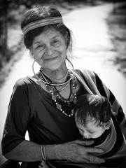 Happiness (memories-in-motion) Tags: portrait bw white black smile face zeiss 50mm 1 women child coto 8 happiness olympus vietnam sw omd cotu pancolar em5 quangnam minorityetnicgroup
