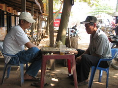 Chinese chess and beer in Vietnam (mbphillips) Tags: fareast southeastasia 越南 ベトナム 베트남 asia アジア 아시아 亚洲 亞洲 mbphillips canonixus400 together two people gente 人 사람들 geotagged photojournalism photojournalist travel vietnam