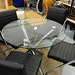 Circular glass chrome table with four chairs
