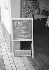 The Mad Jam Woman (bigalid) Tags: bw film sign pen 35mm market kodak olympus northumbria april expired amble 2016 bw400cn ee2