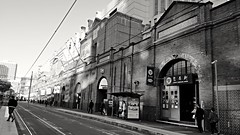 Paddys Markets in monochrome (Merrillie) Tags: people building architecture transport markets sydney samsung australia historical haymarket trams s7 tramline paddysmarkets samsungs7