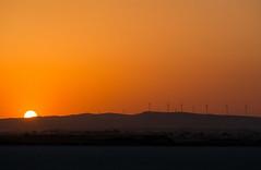 Sun and Salt (Alex Apostolopoulos) Tags: sunset sky orange sun outdoor sony cyprus saltlake half windturbine sel55210 sonye55210mm ilce6000 sonya6000